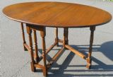 SOLD - Oak Oval Gateleg Dining Table to Seat Six